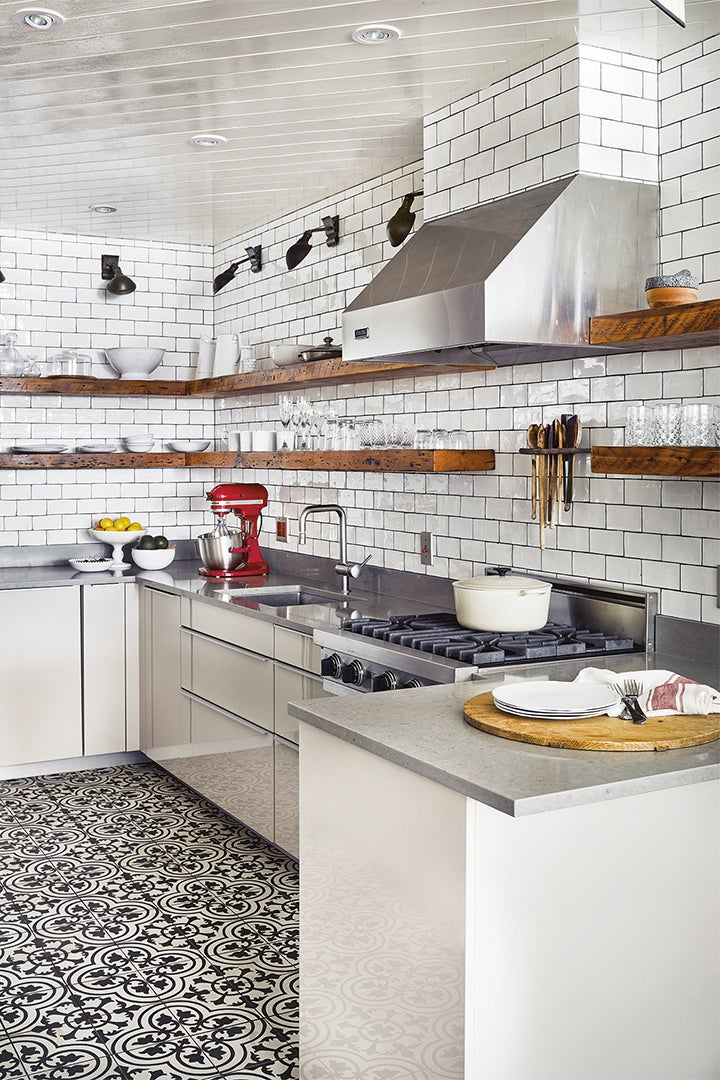 white kitchen with wood open shelves