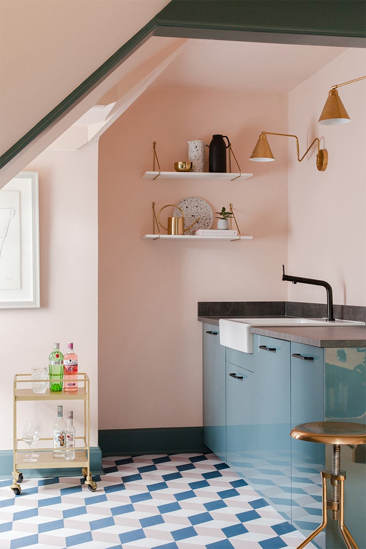 pink and blue kitchen with blue tile floor