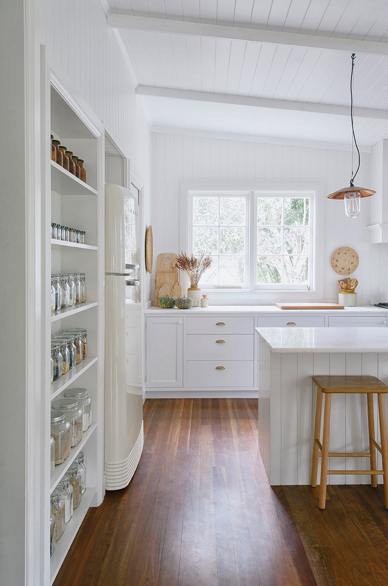 Kitchen with exposed pantry