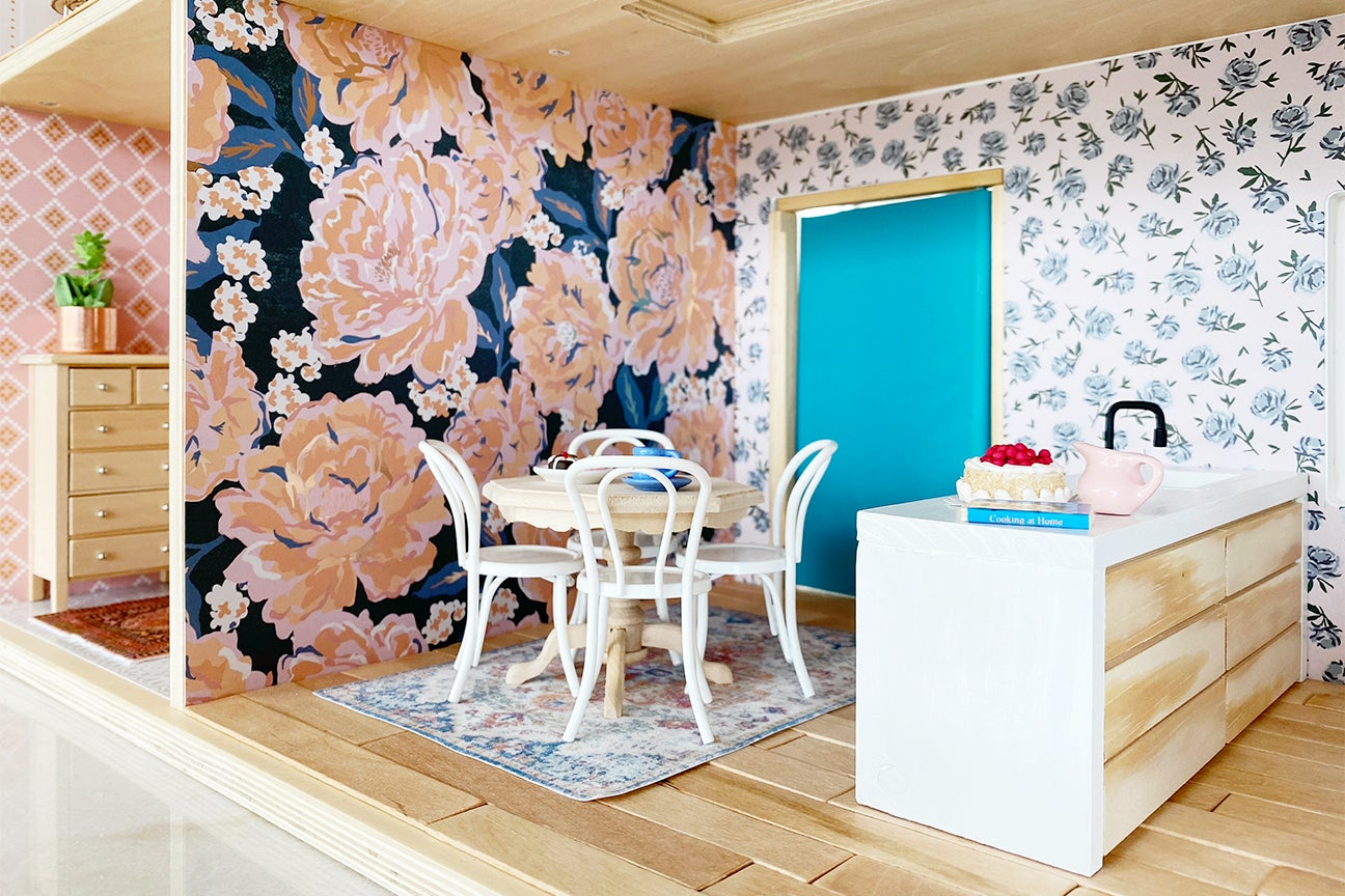 dining room with bold floral wallpaper