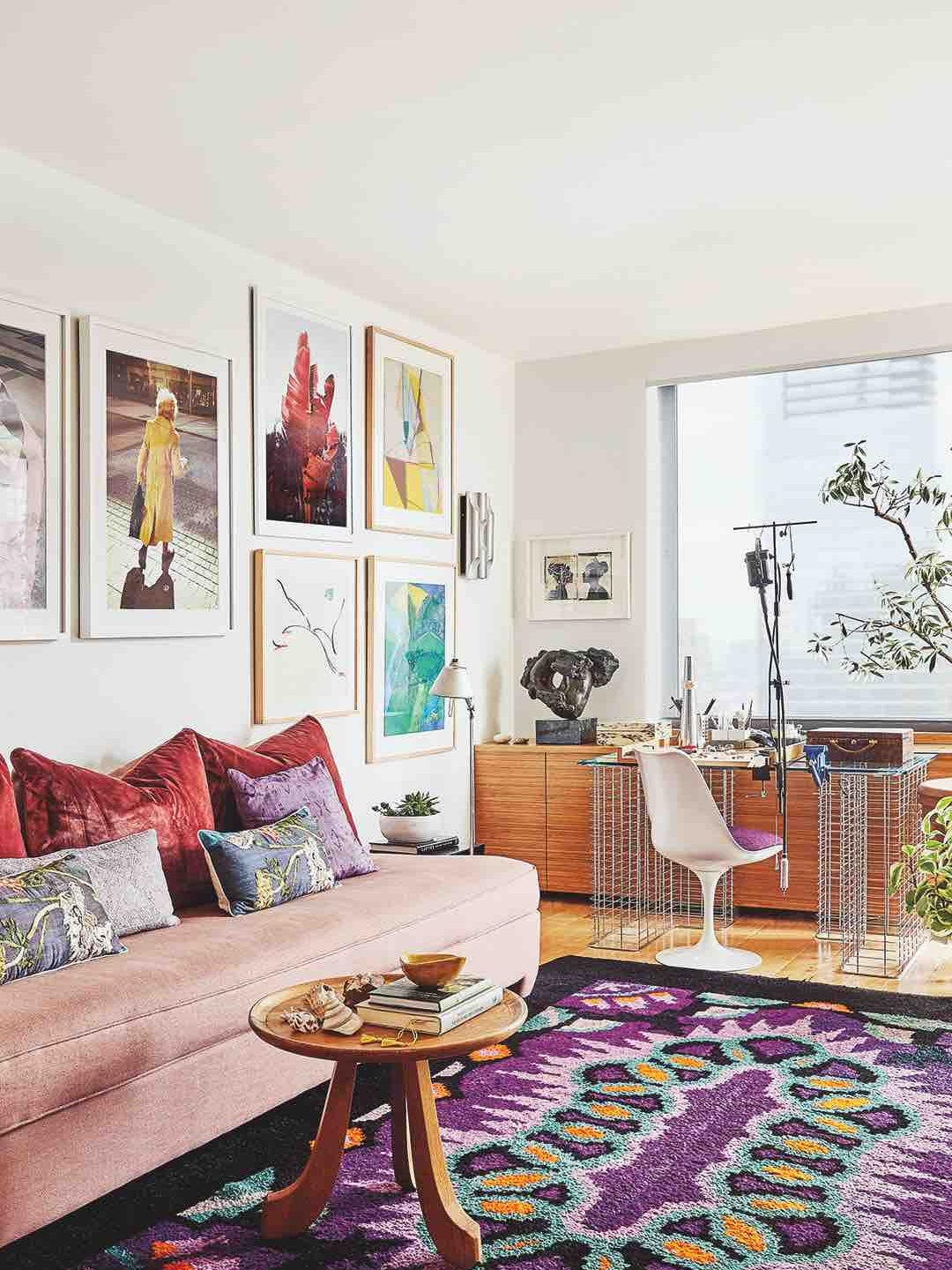Living room with wall art and pink sofa