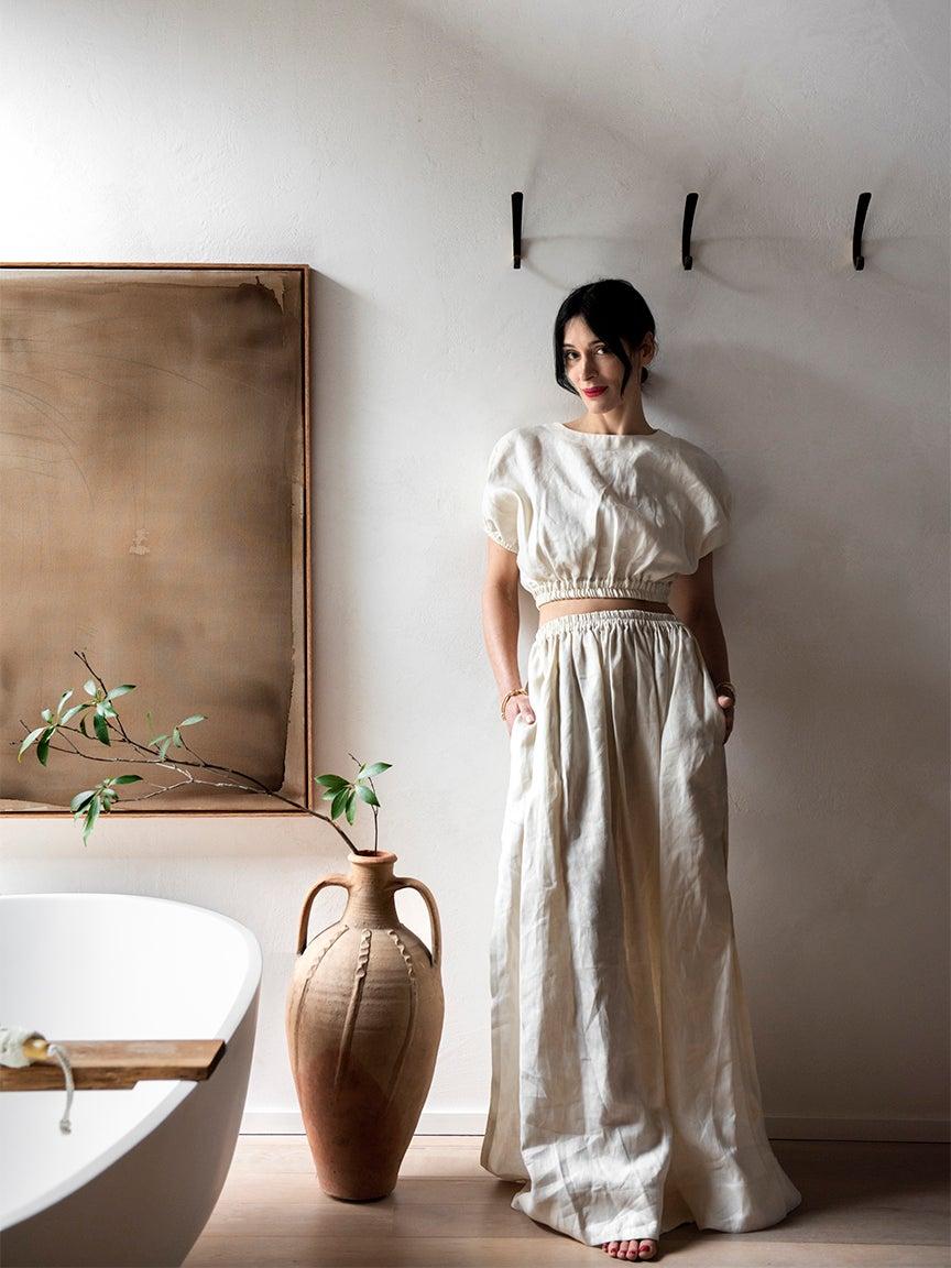 Athena calderone in bathroom next to white bath tub