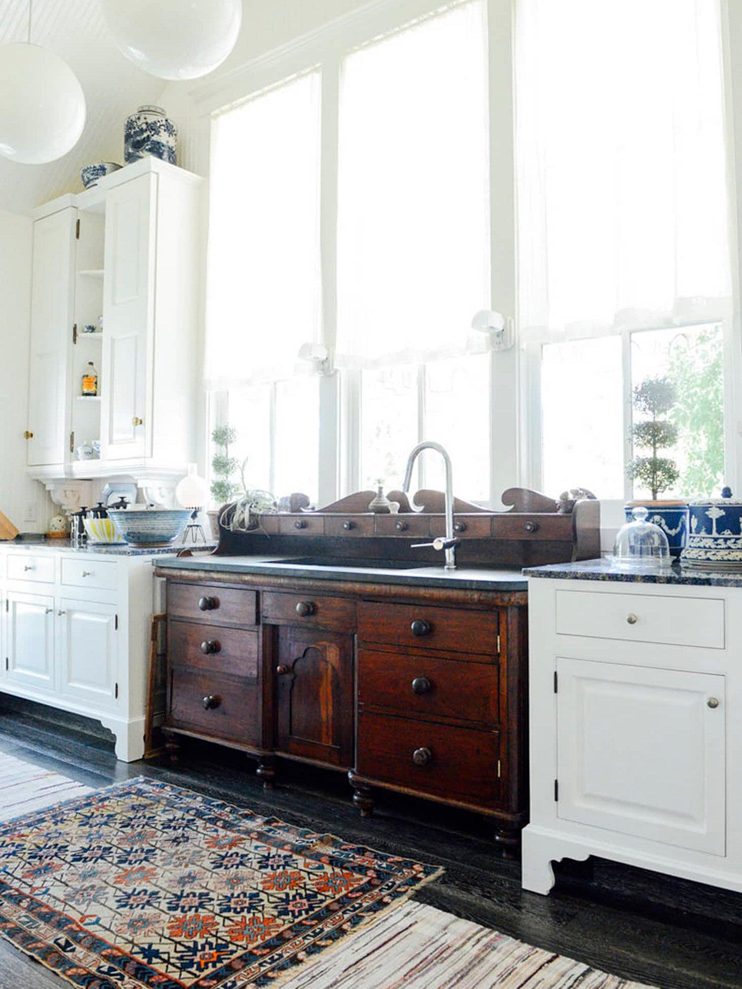 white kitchen with antique wooden sink