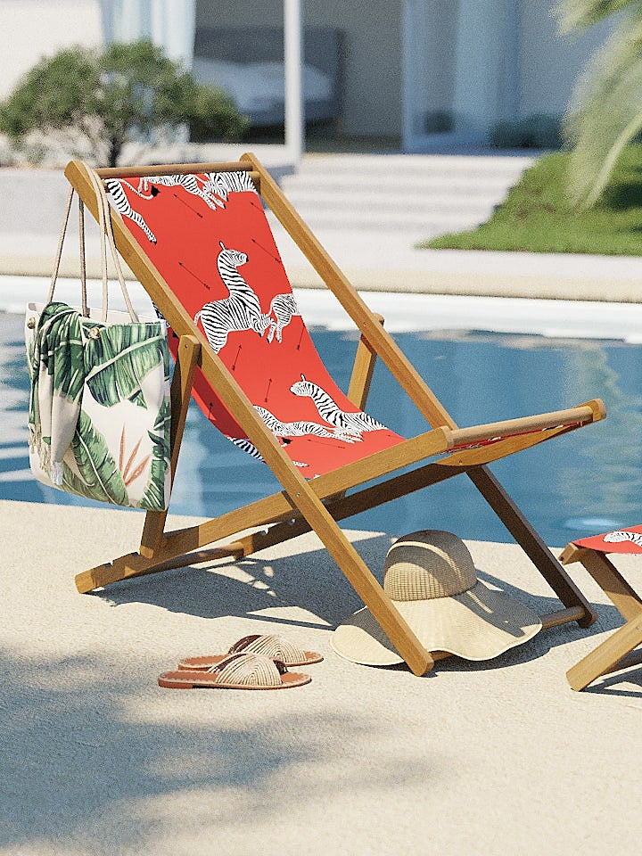 red zebra scalamandre folding chair by pool
