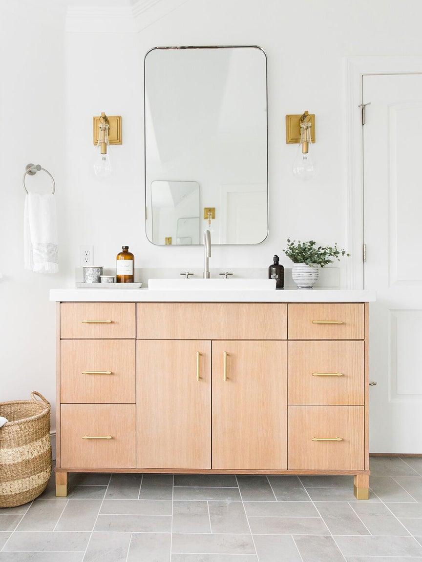 wooden vanity in bathroom with grey tiles