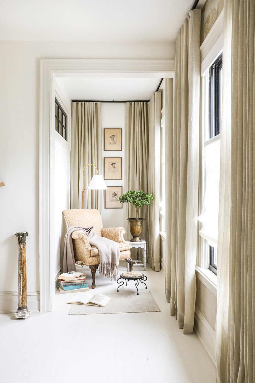 reading nook with beige curtains