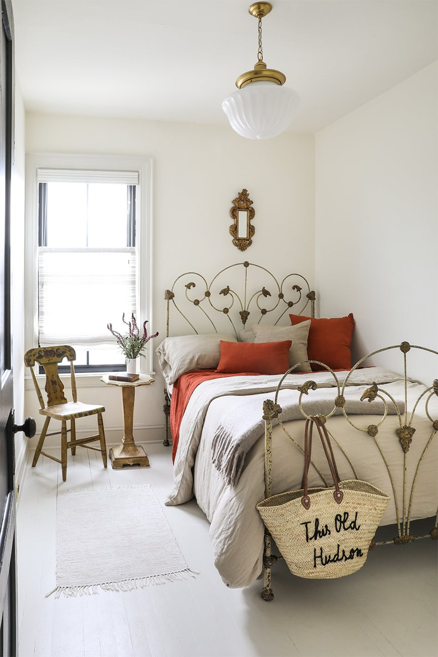 white bedroom with antique bed frame