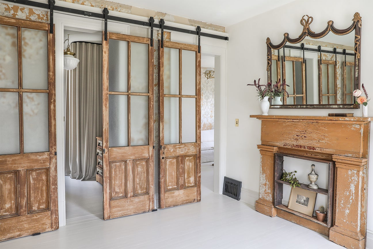 antique sliding doors and vintage fireplace