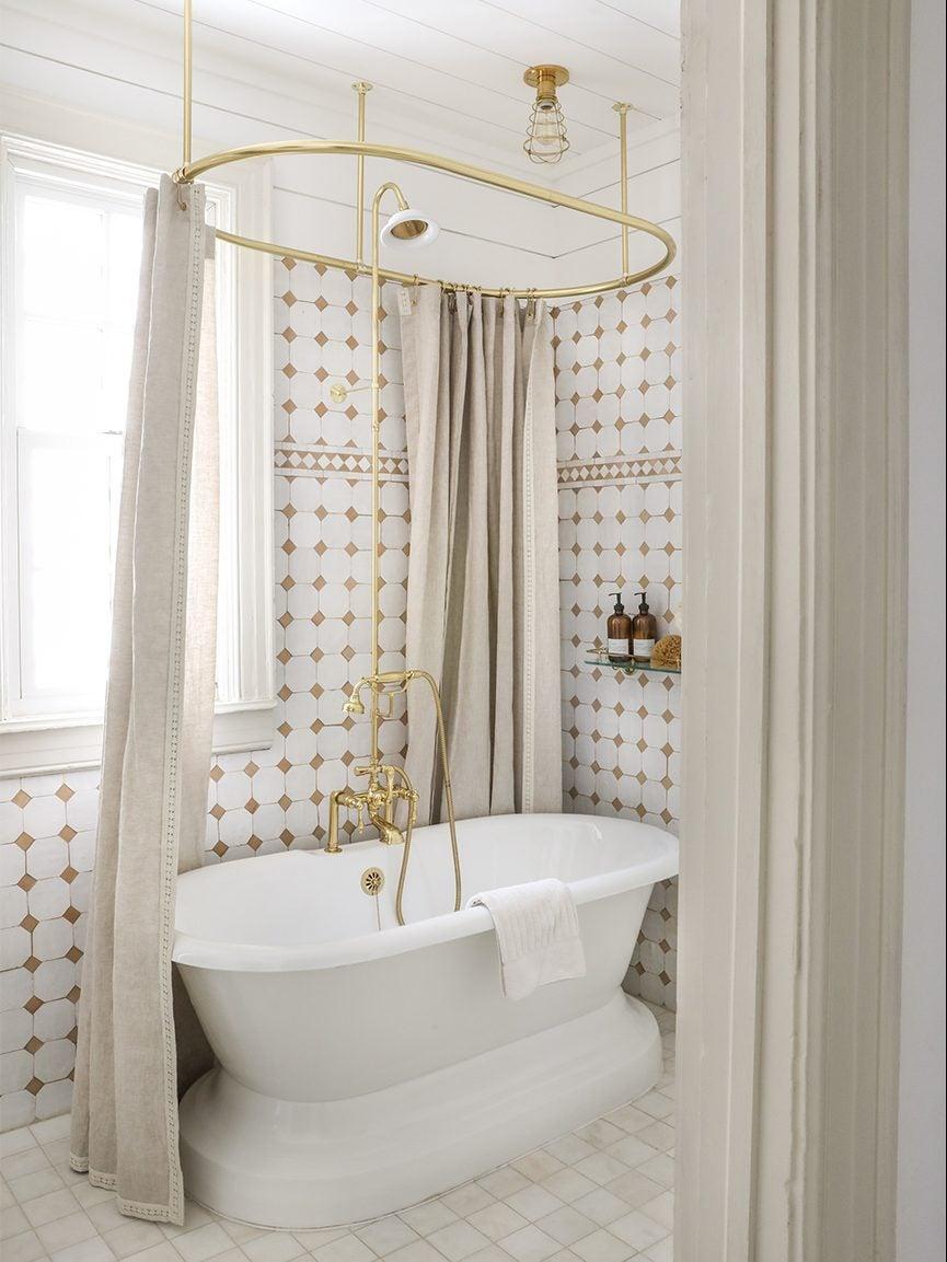 shower nook with tiled bathtub