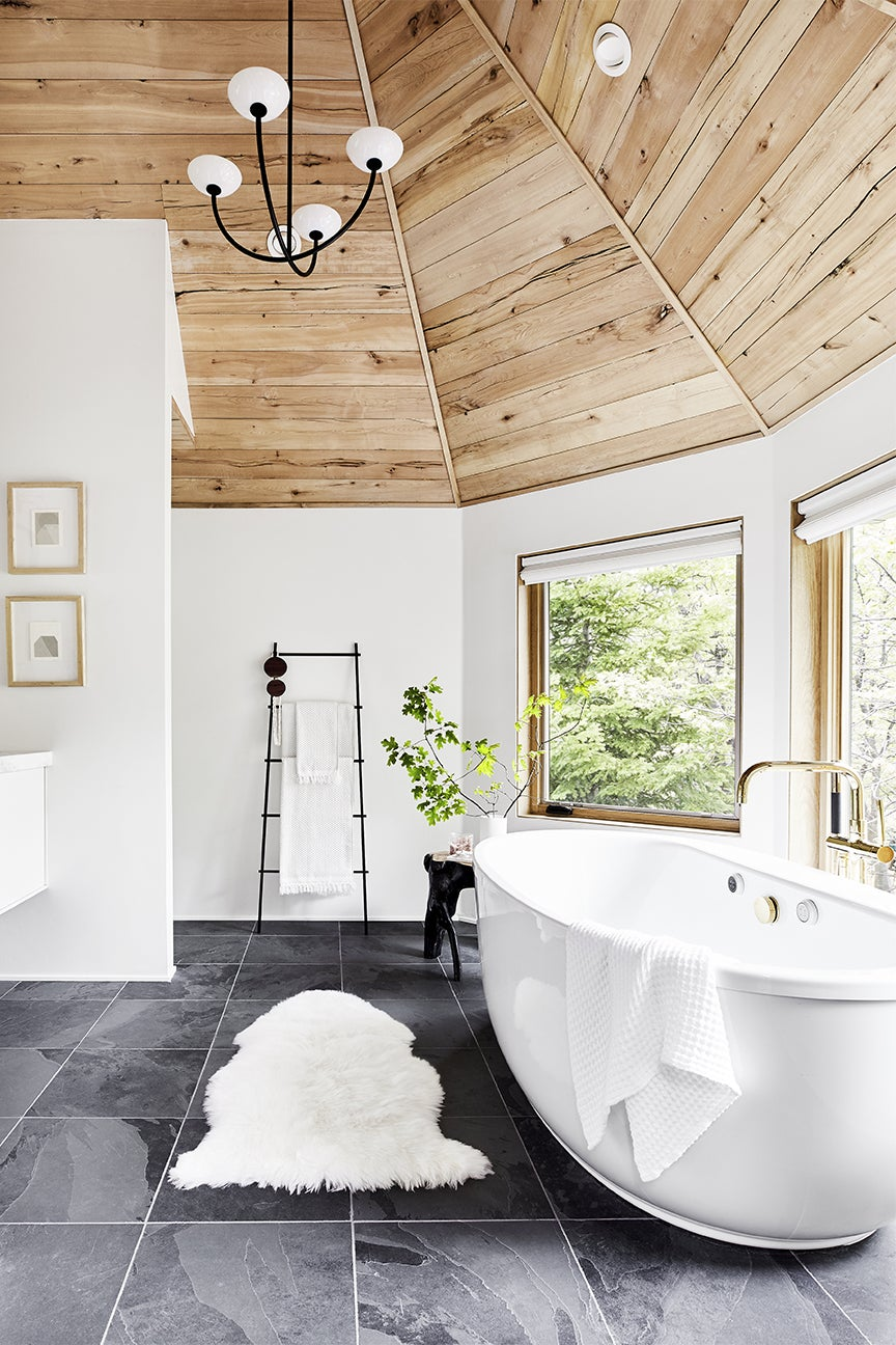 sloped ceiling bathroom with giant white tub
