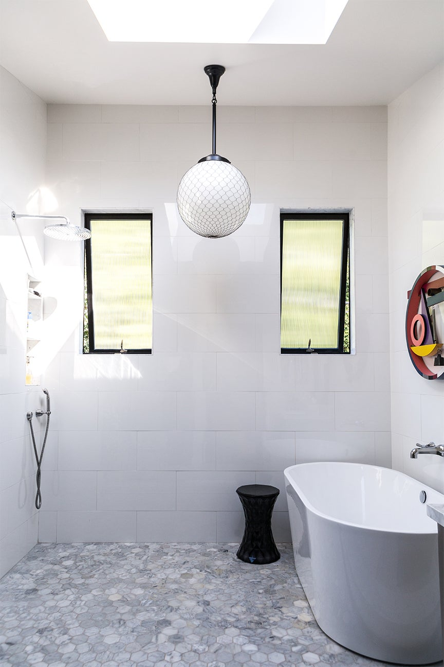 white and grey bathroom with long ceiling pendant