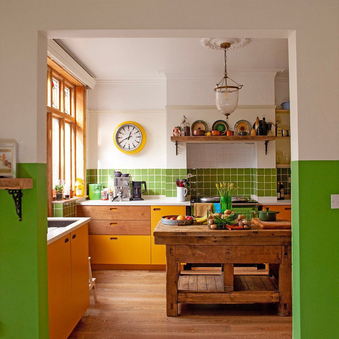 Green kitchen with antique island