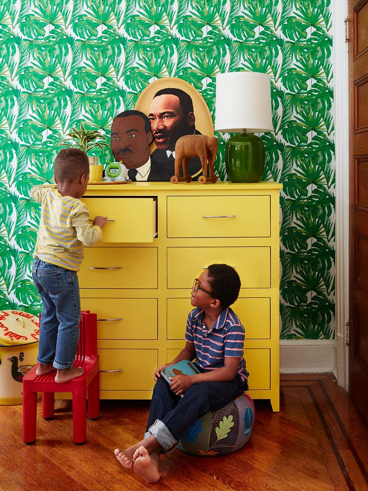 Boys playing in a bedroom with yellow dresser