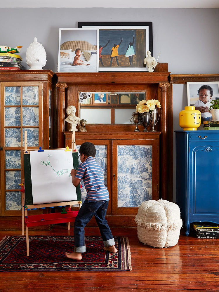 Boy painting on easel