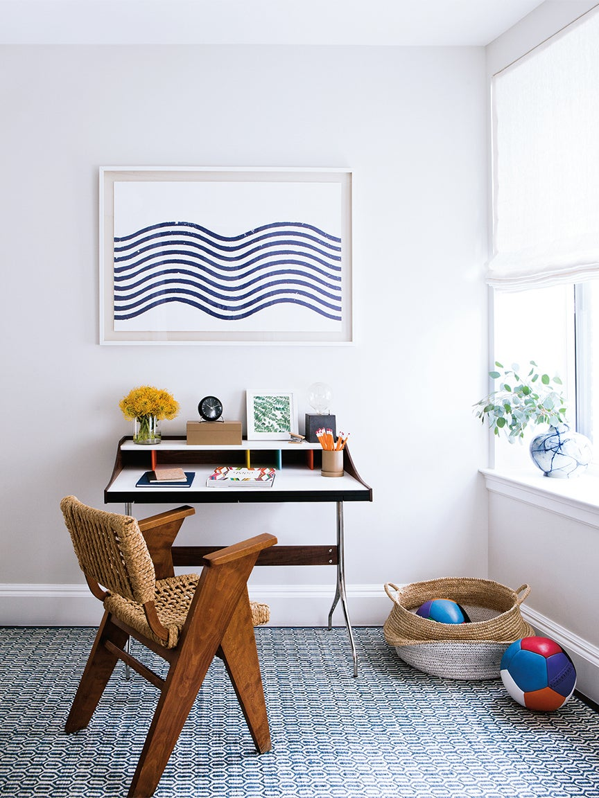 white office with blue artwork hanging