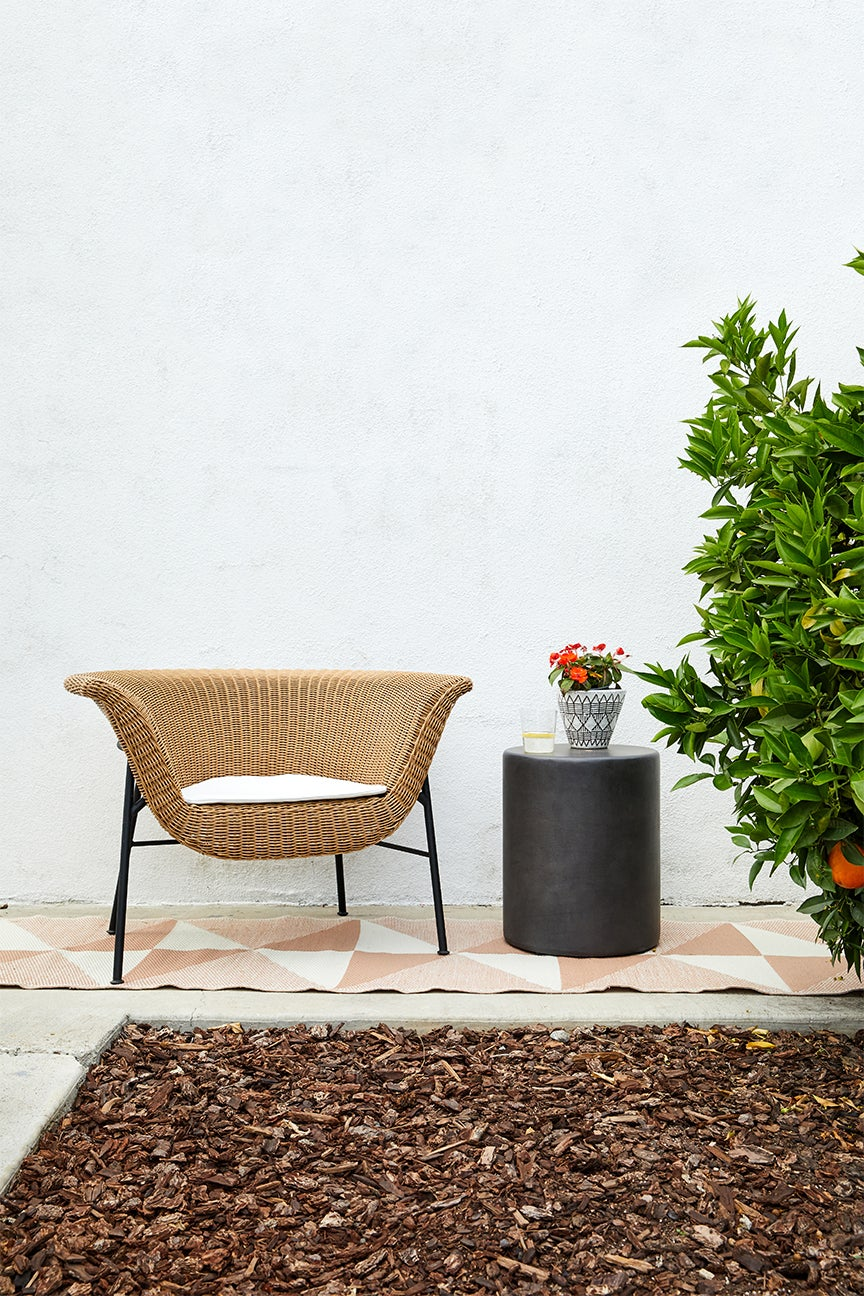 rattan chair next to black table