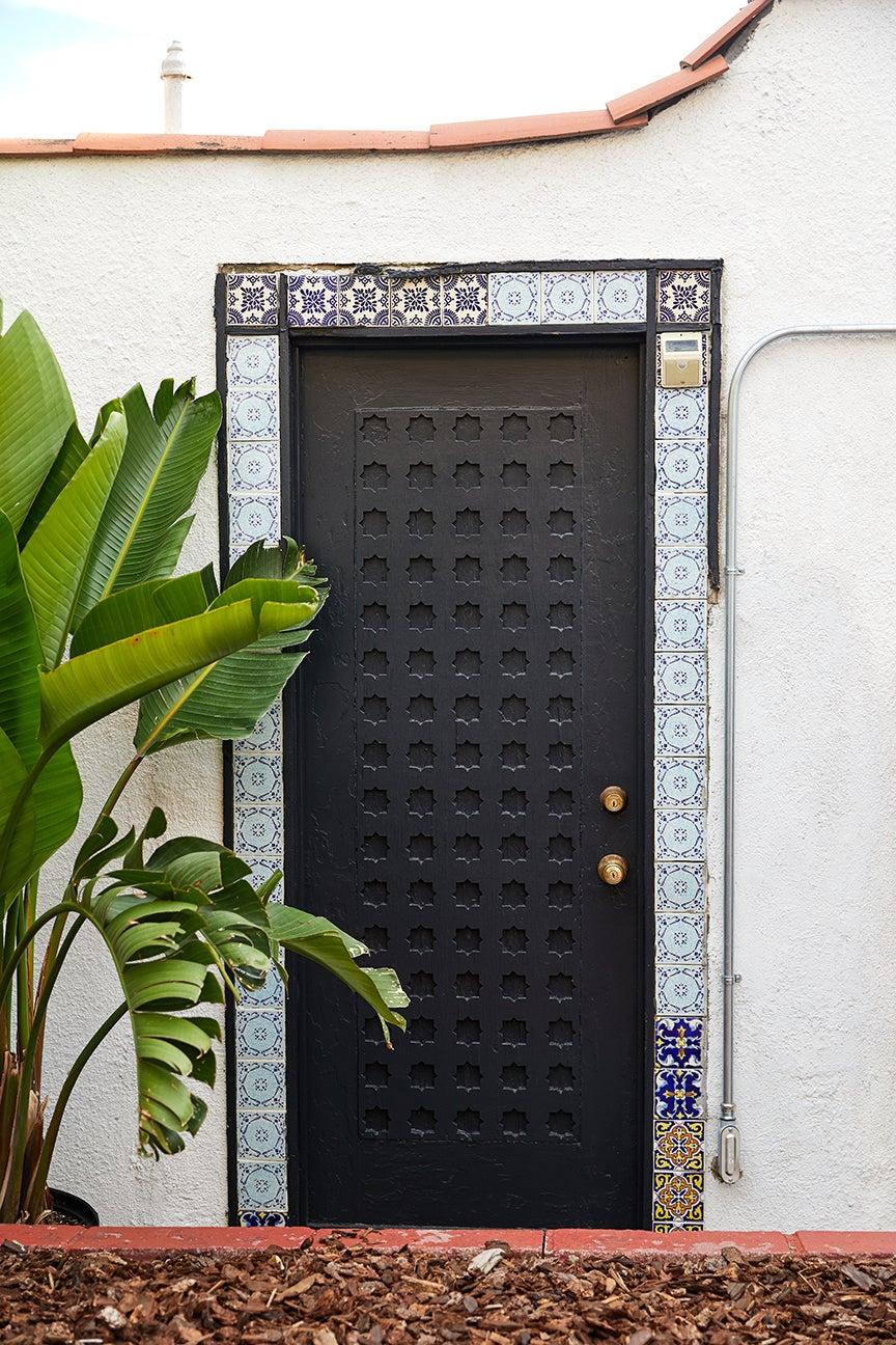 ornate door painted black