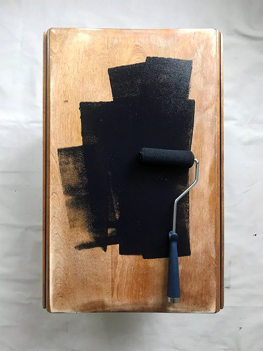 Top of table being painted black
