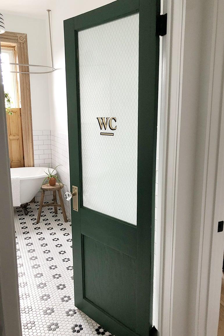 Vintage green door with chicken wire glass