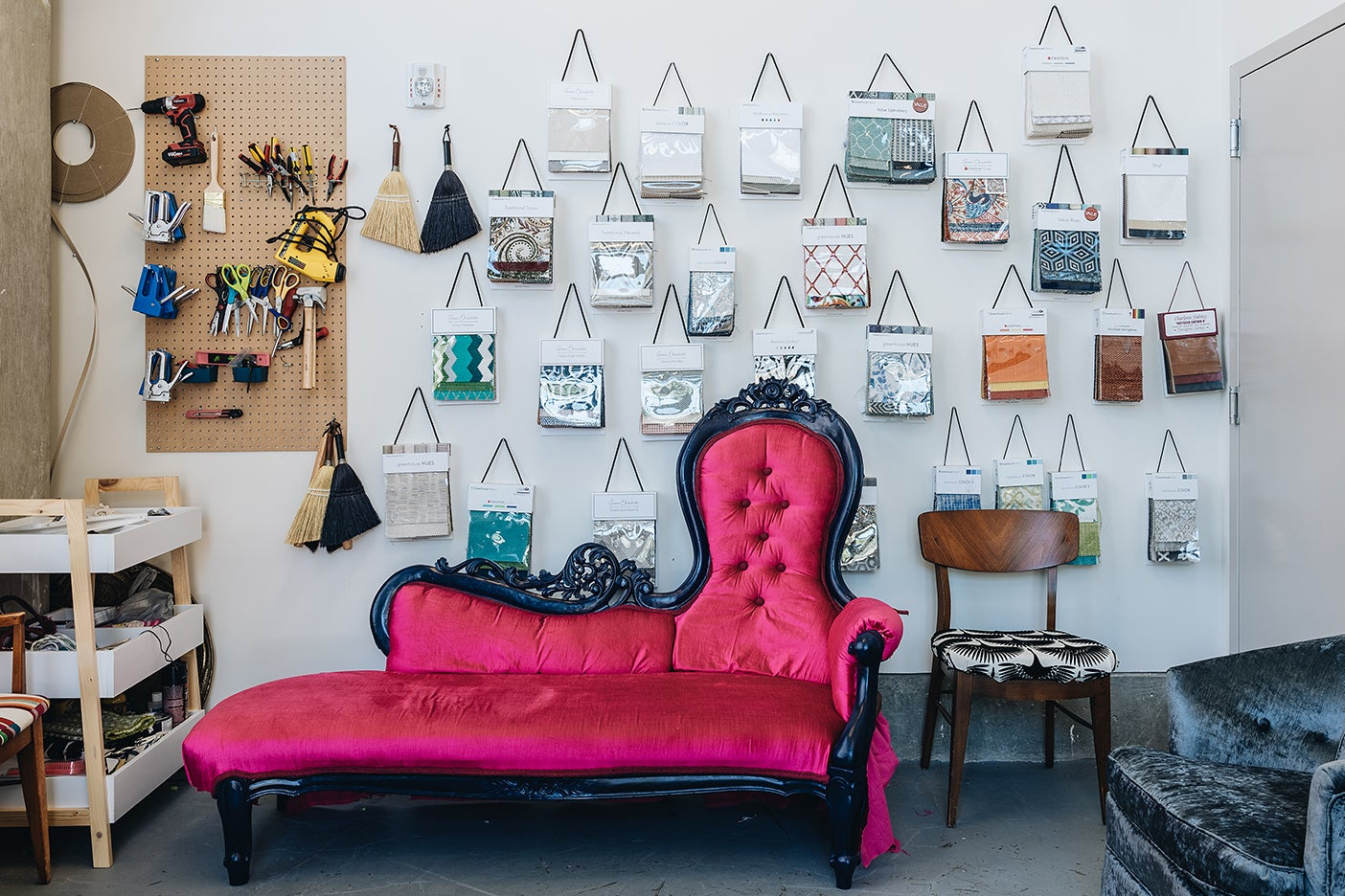 pink couch with fabric hanging on wall