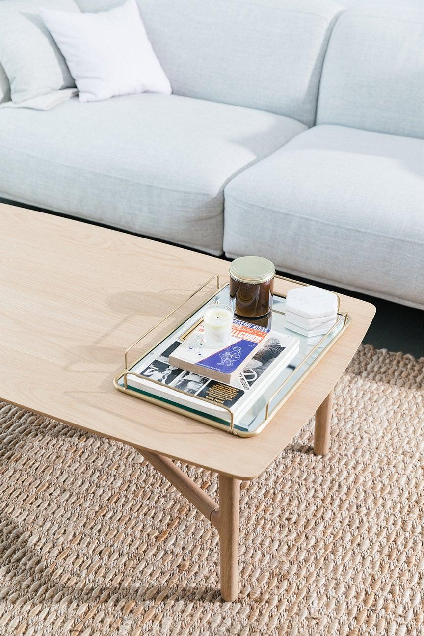 Light blue sofa with birch coffee table
