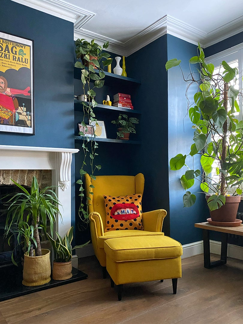 blue living room with fireplace and yellow arm chair