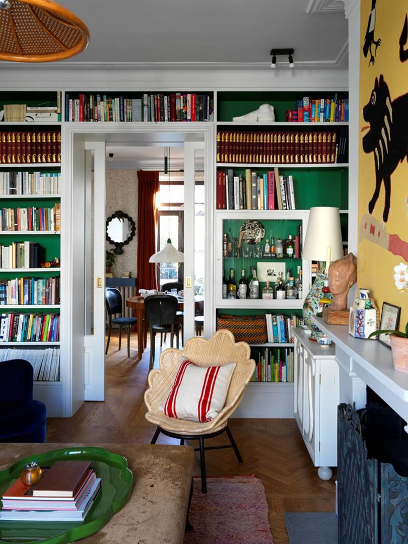 emerald green build in bookcase in living room
