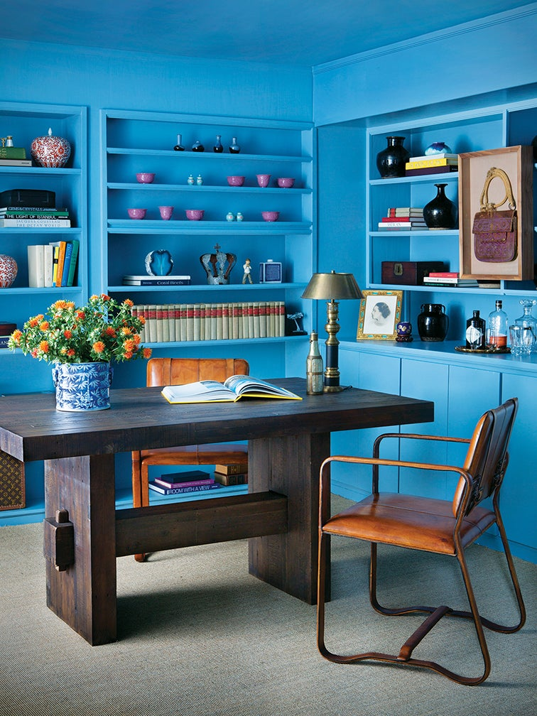 bright blue wall colors and built-in bookshelf in home office