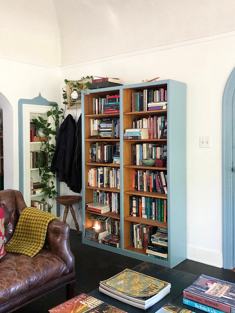 living room with wooden bookcase painted blue