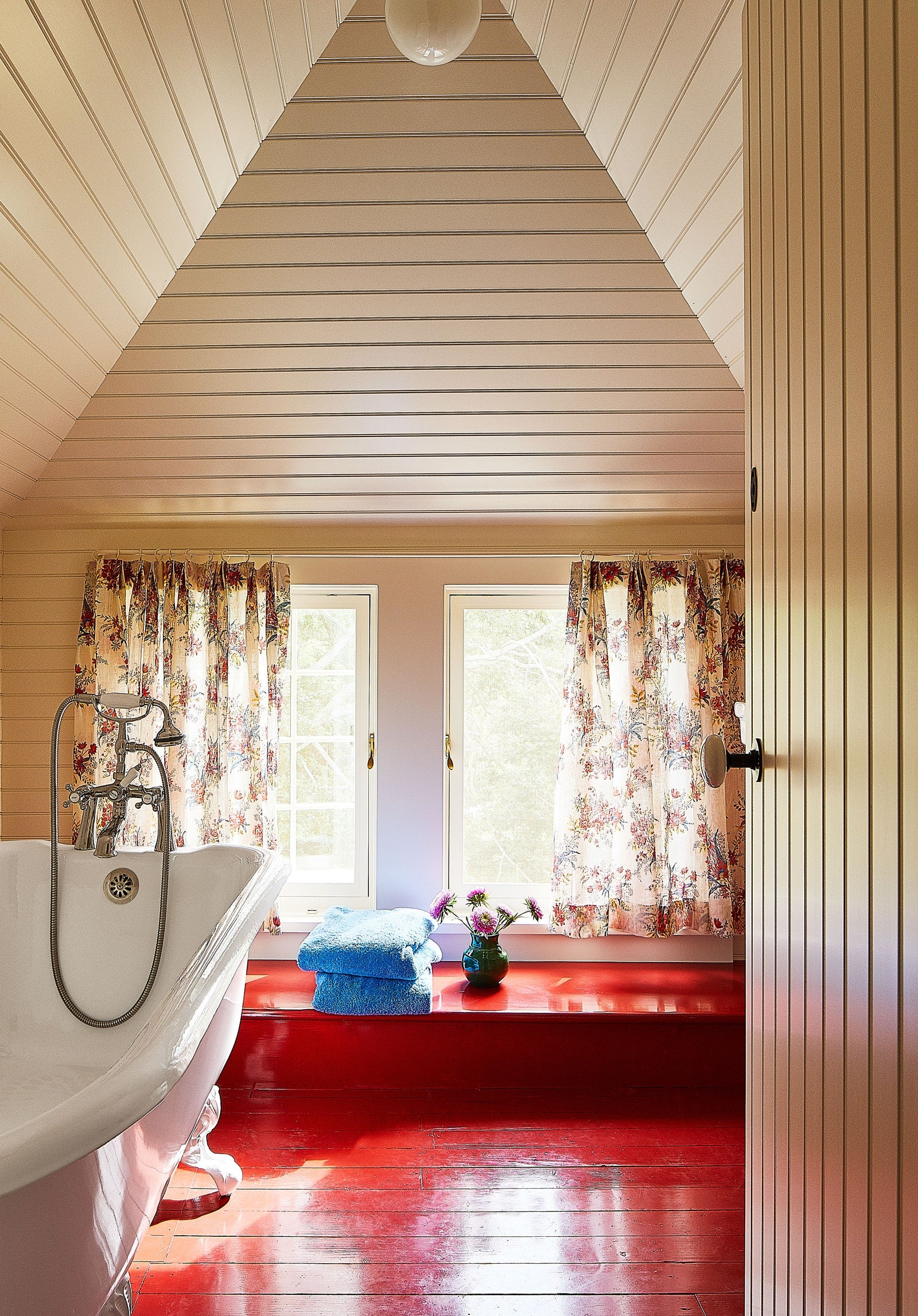 Country bathroom with red painted floors
