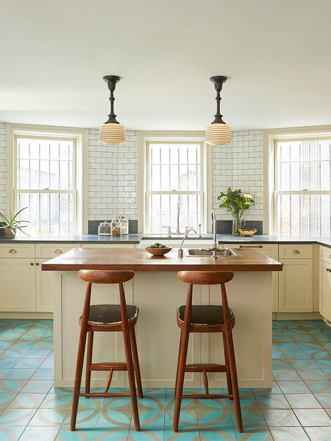 farmhouse style kitchen with blue floors
