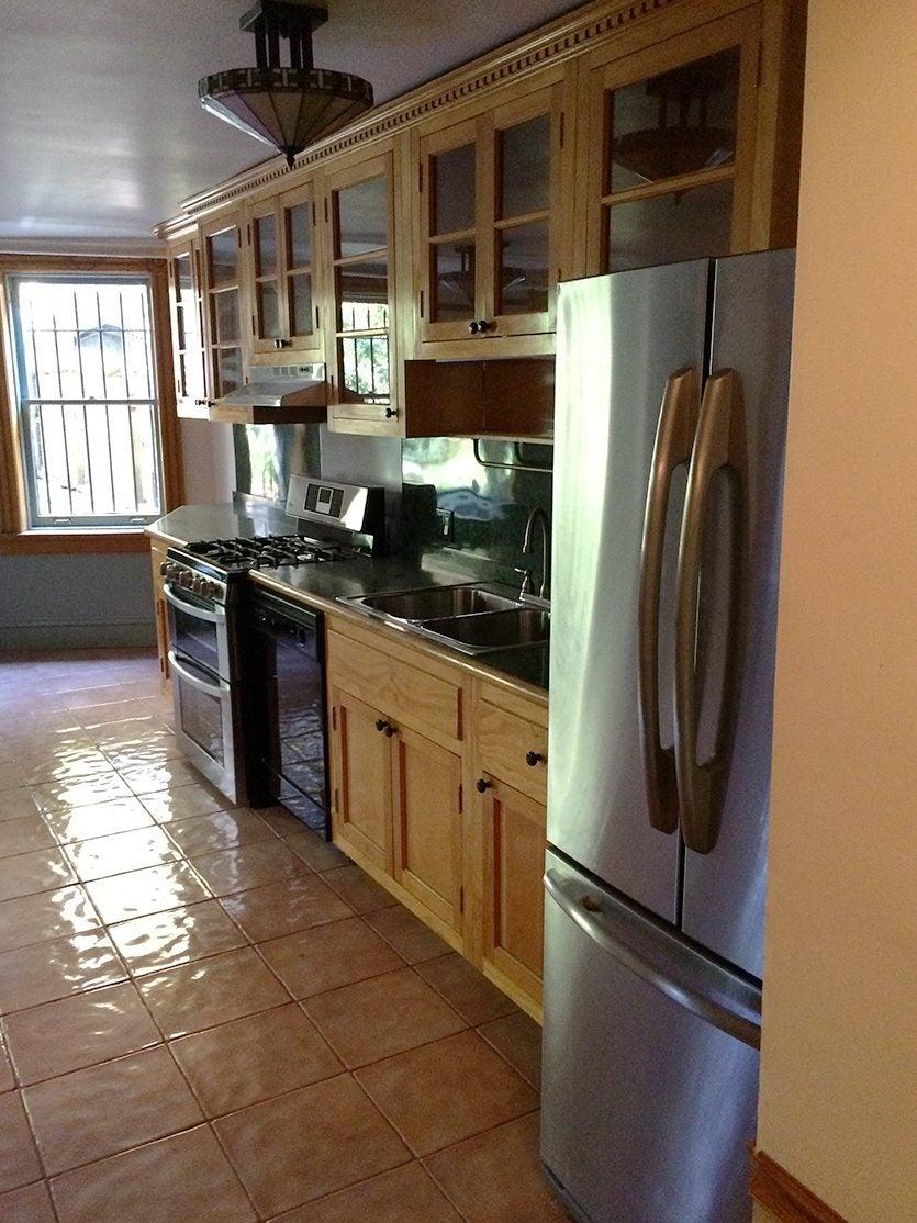 dark kitchen with dated cabients