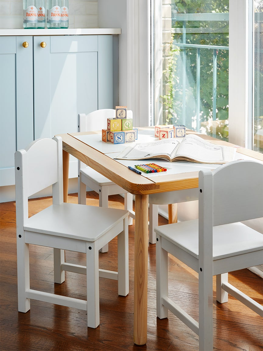 Kids table in blue kitchen