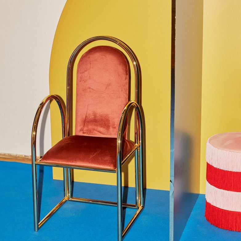 red chair against yellow wall
