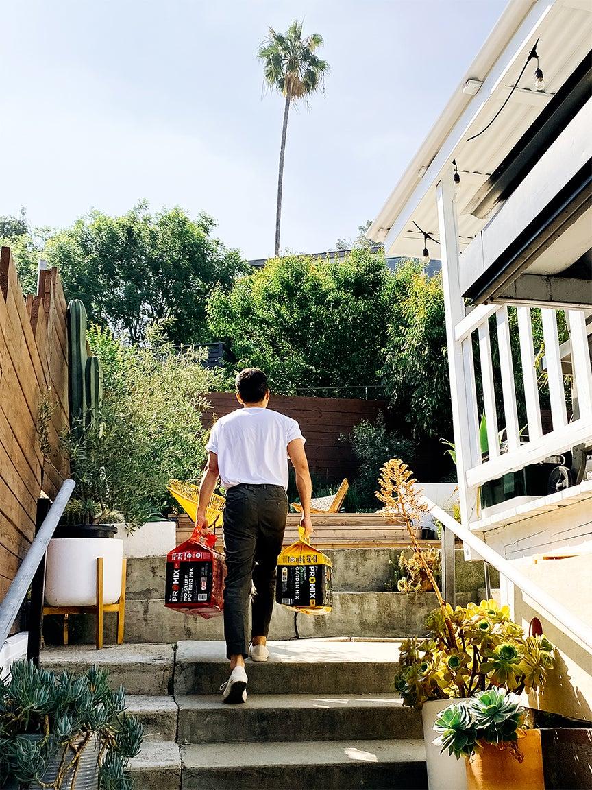 man walking up outdoor steps