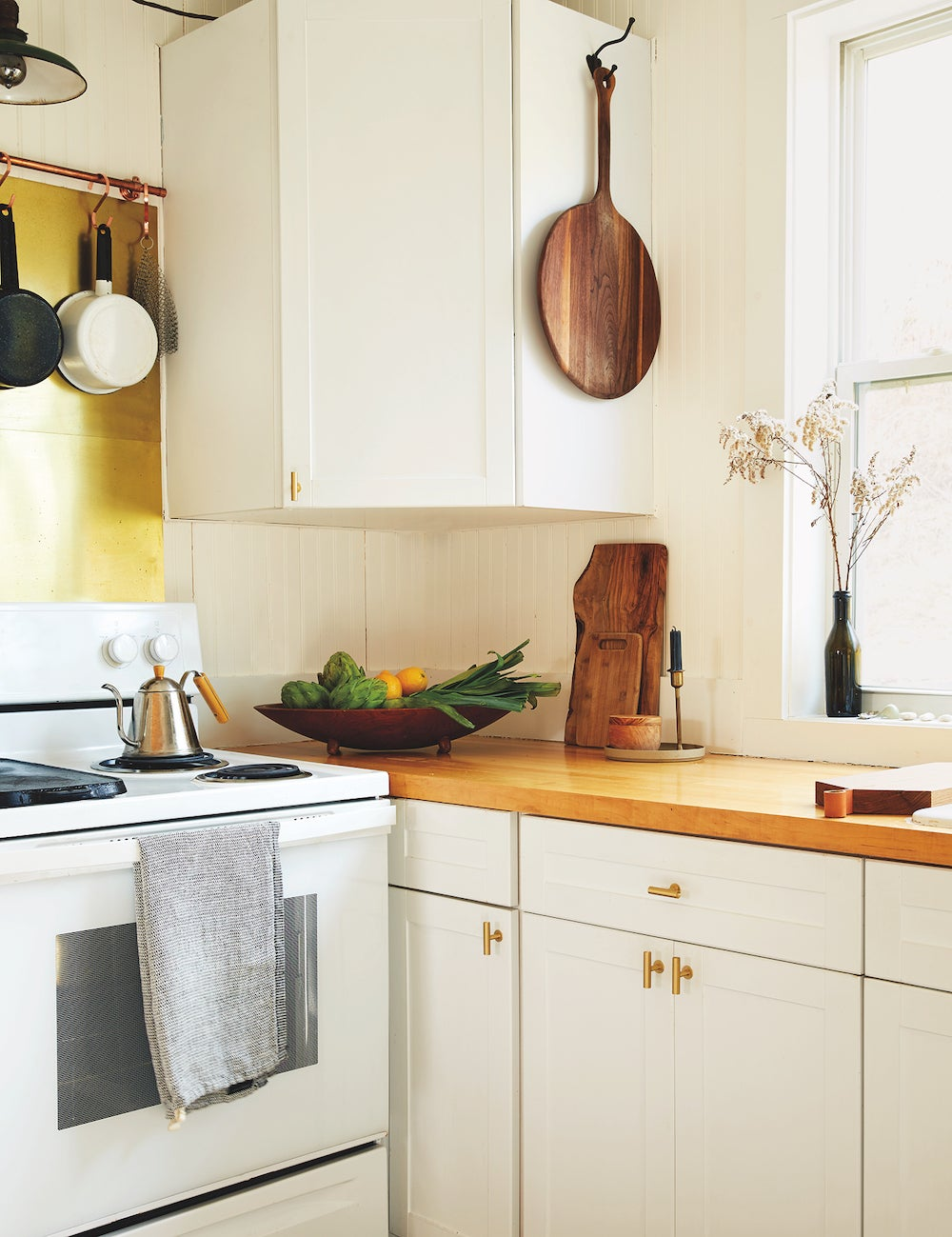 white cabinets with wood counter