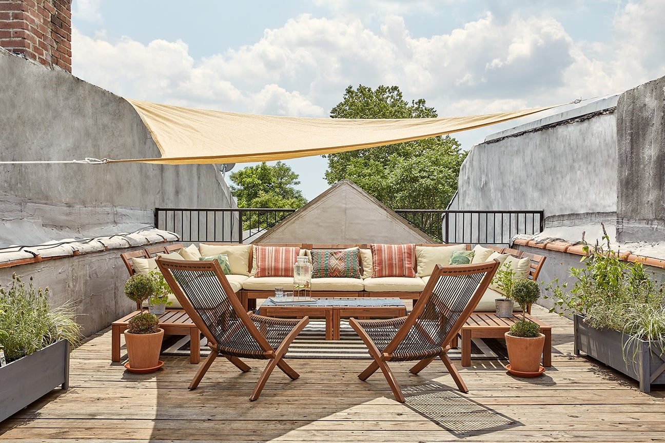 outdoor patio with tent and planters