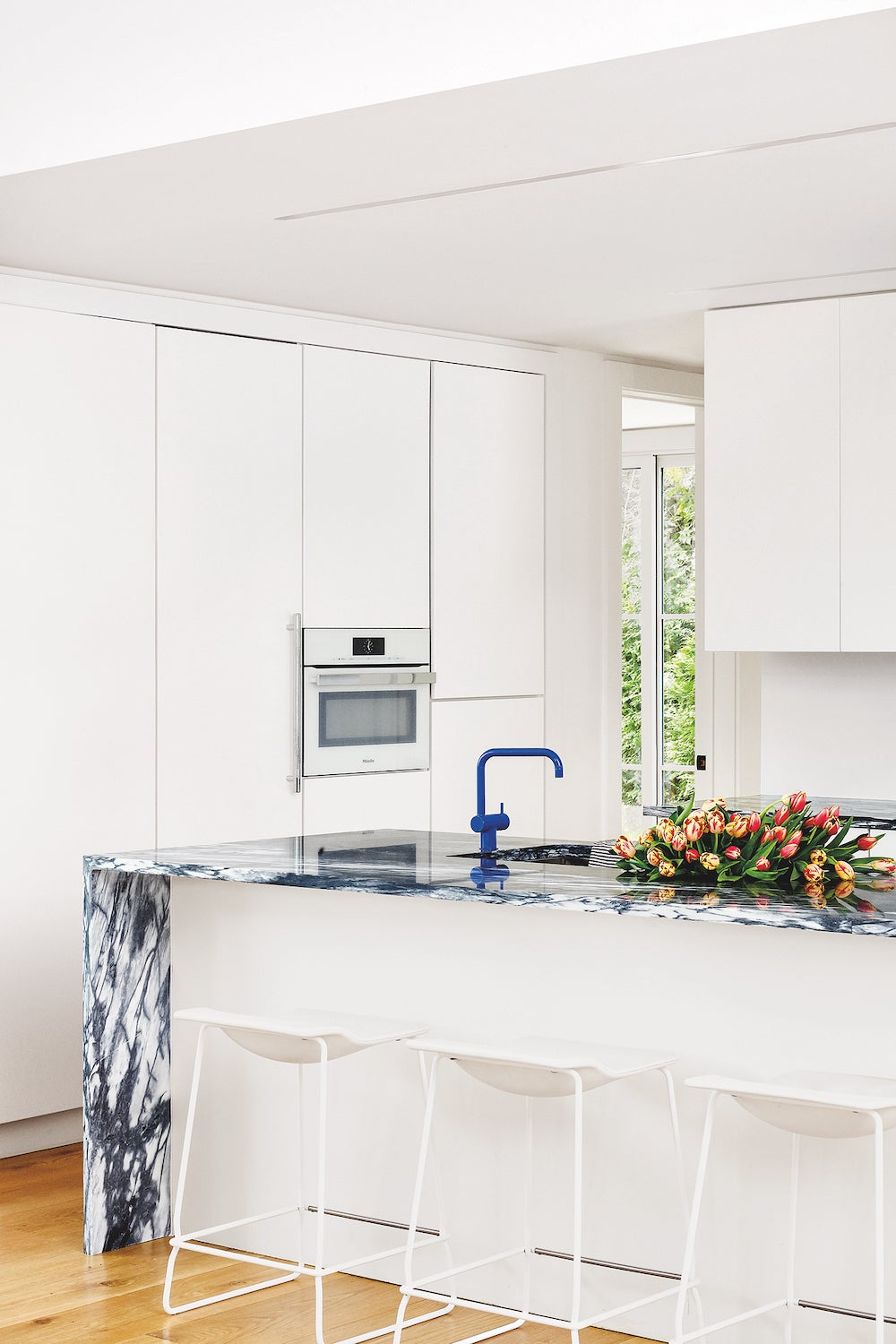 white cabinets with blue island