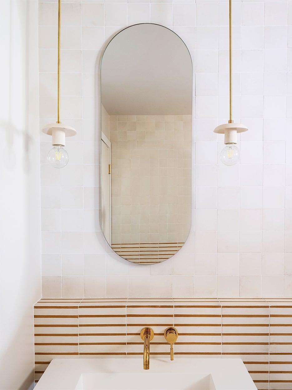 white bathroom with horizontal striped backsplash