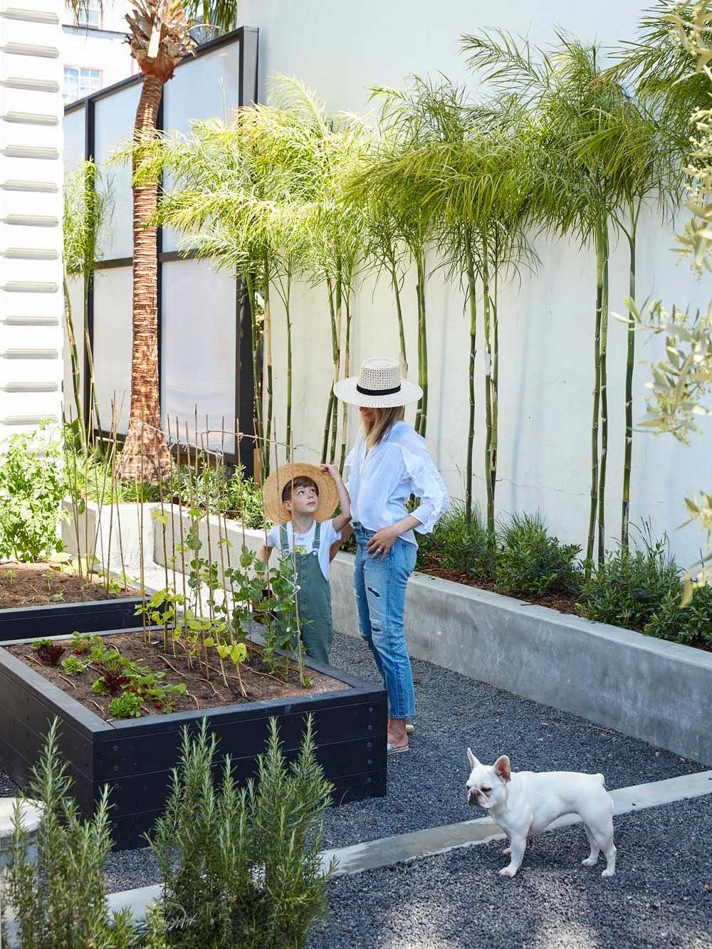 Erin Hiemstra gardening with her son
