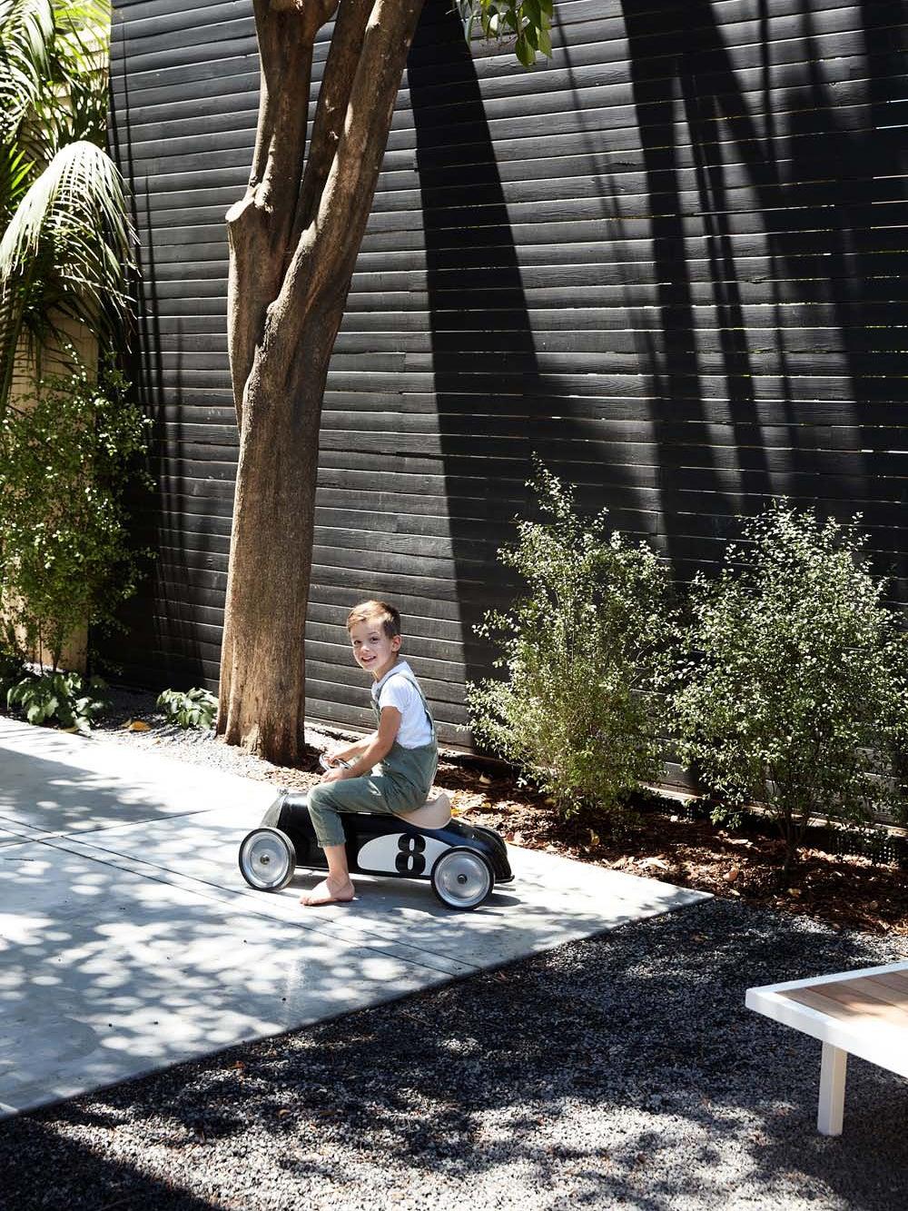 Erin Hiemstra's son in the backyard
