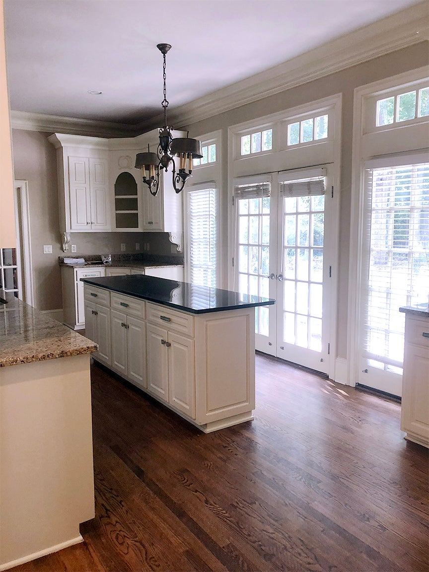 dated kitchen with small island