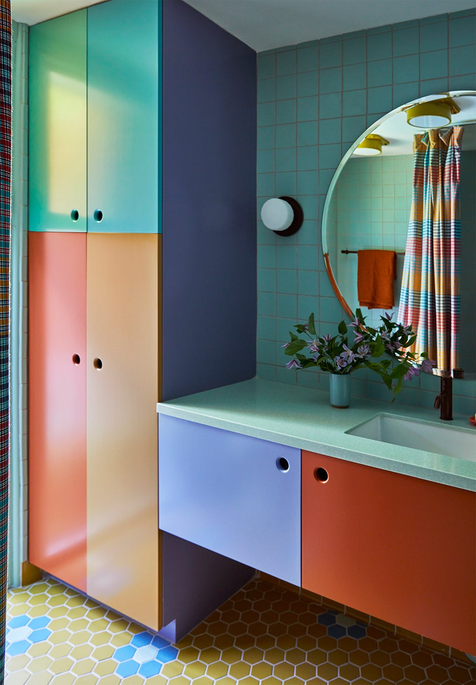 multicolored bathroom with green tile backsplash
