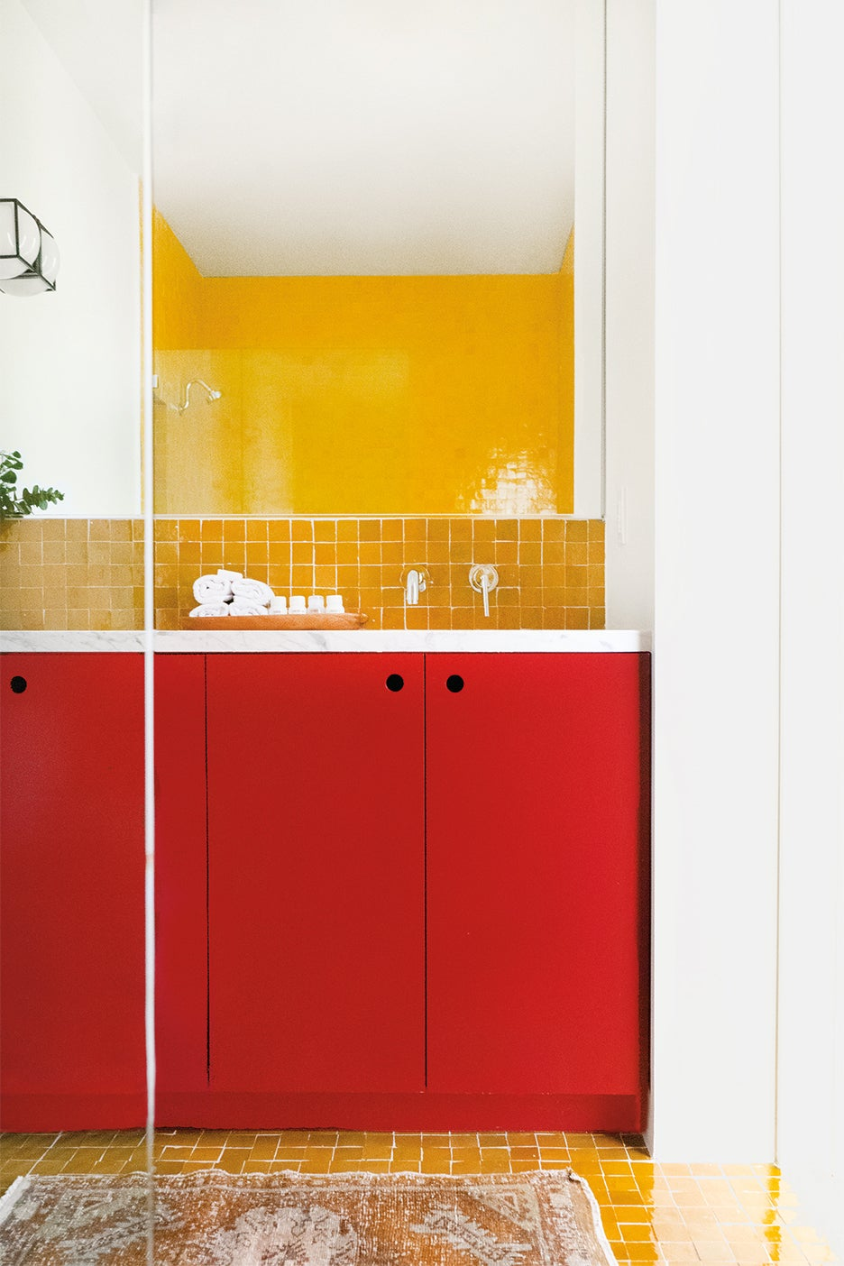 yellow zellige tile backsplash red cabinet