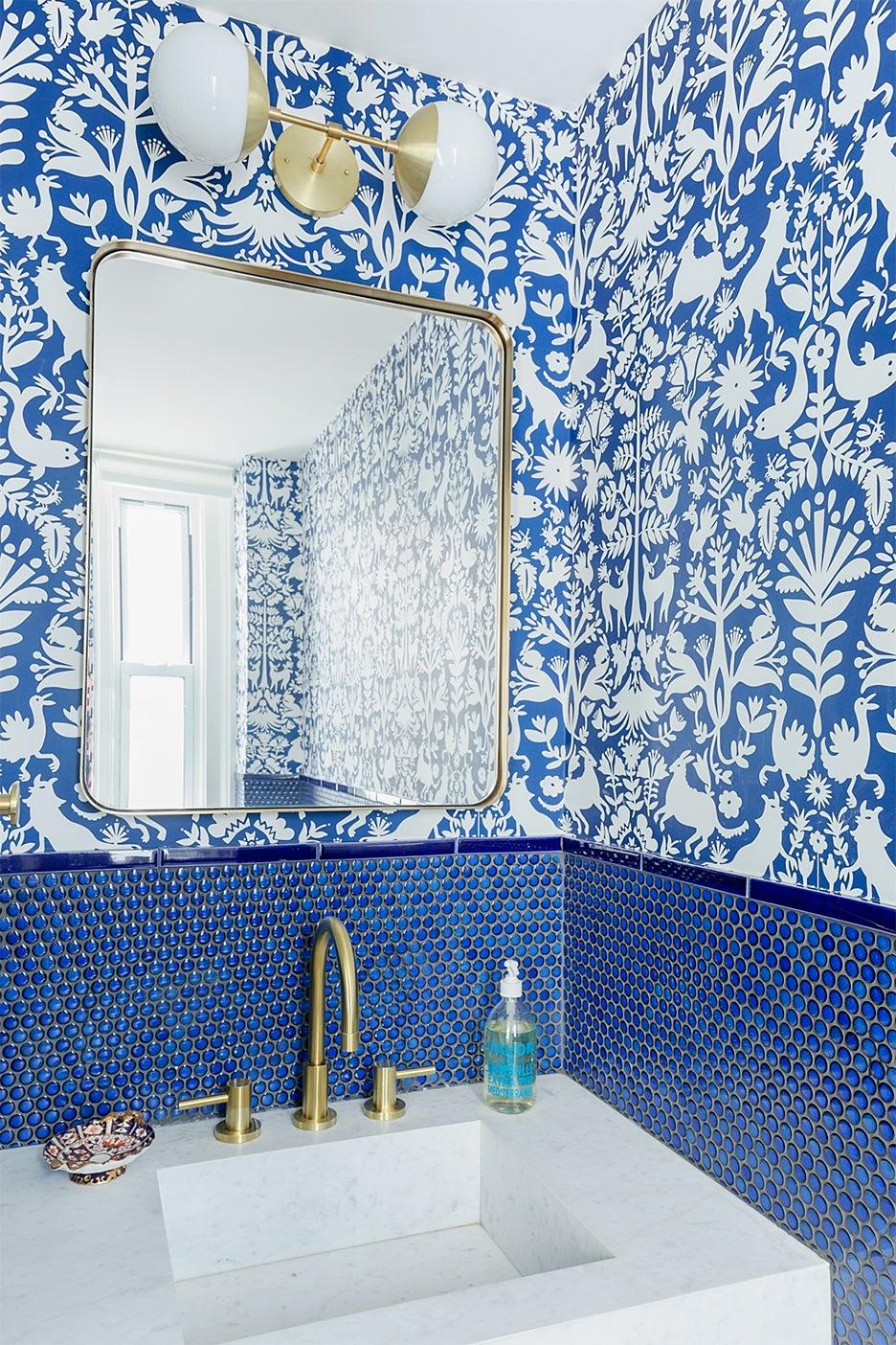 blue bathroom with penny tile backsplash