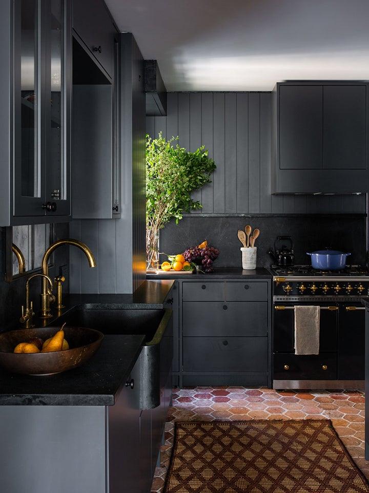 Dark kitchen with terracotta floors