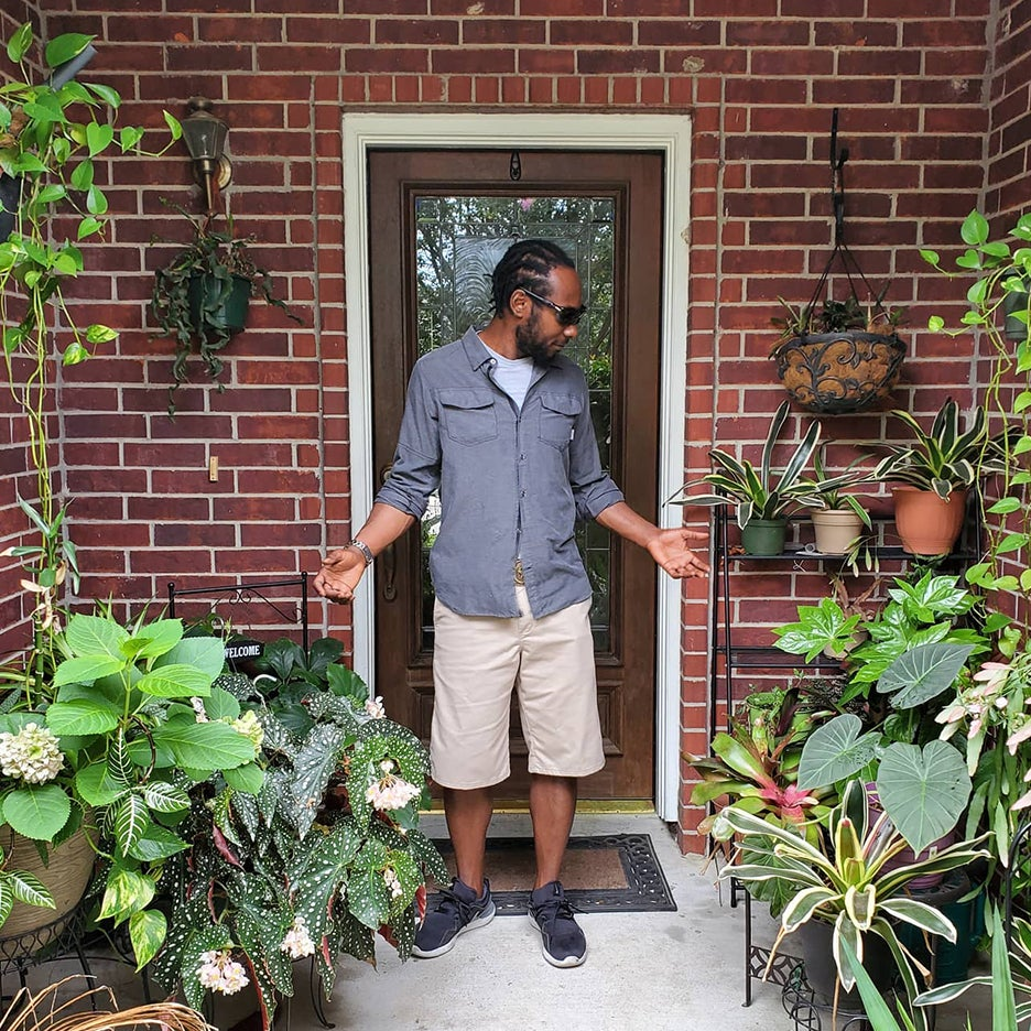 Marcus surrounded by plants