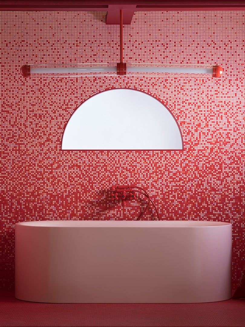 red and pink tile bathroom with big pink tub