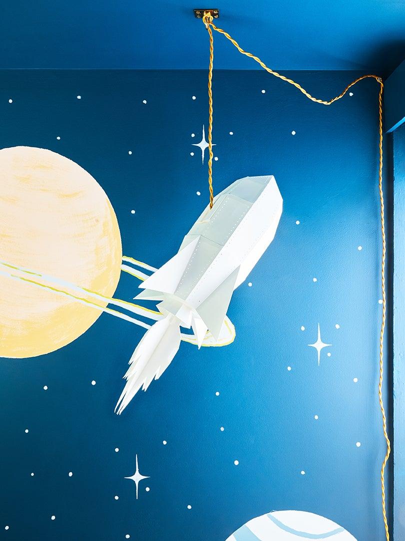 Rocket ship lamp in kids room