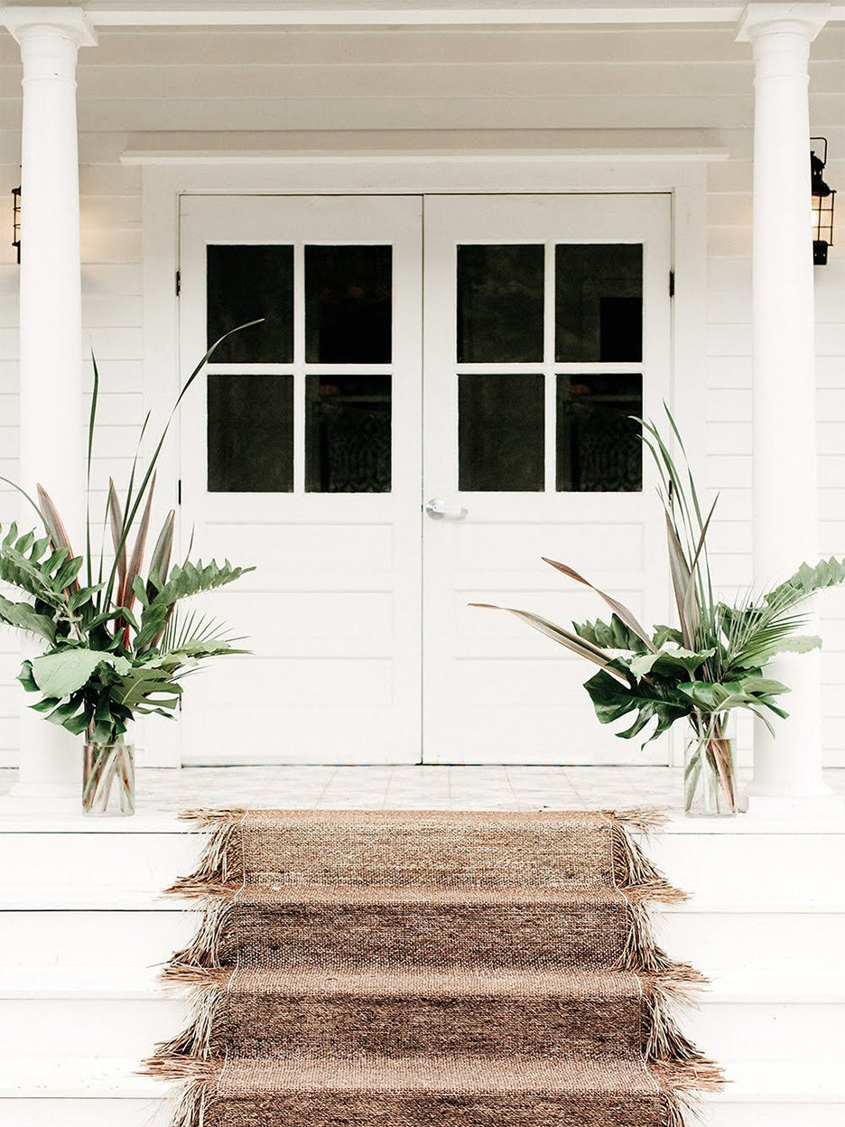 white home with jute carpet on stairs